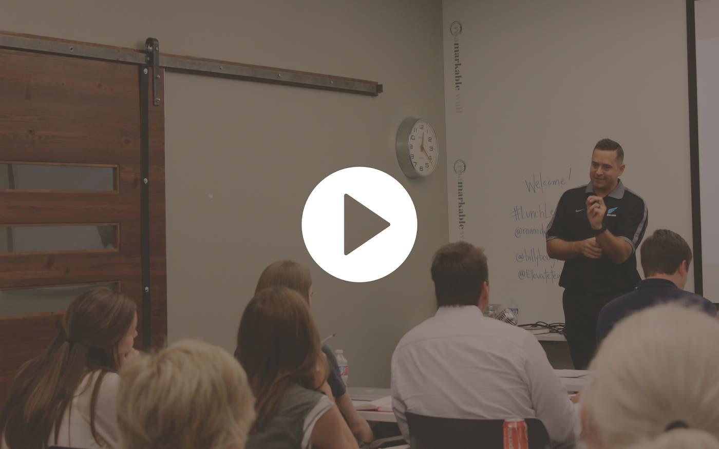 Video still of meeting happening in meeting space