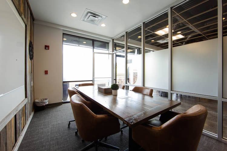 Boardroom with windows, whiteboard and mounted TV in Alpharetta, GA