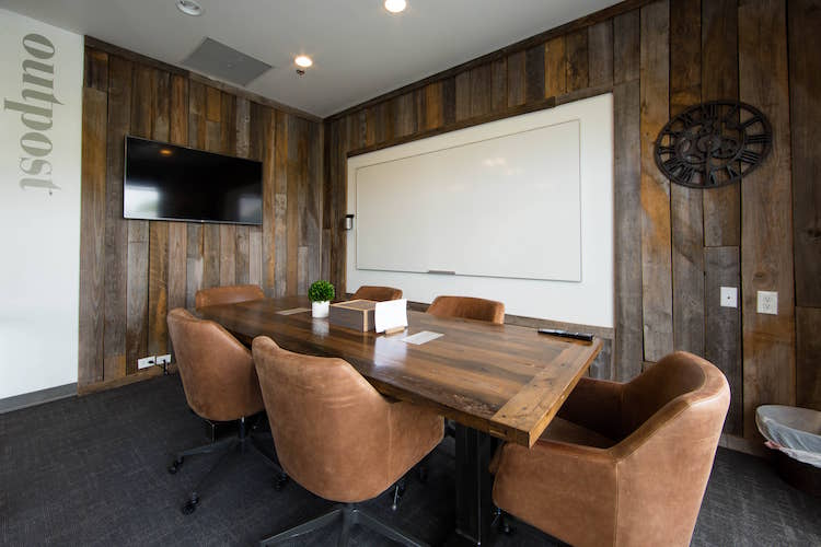 Luxury boardroom with wood walls seating 8 people in Alpharetta, GA