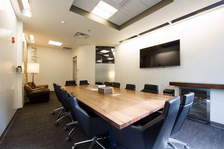 Technology-equipped conference room in Alpharetta, GA seating 12 people