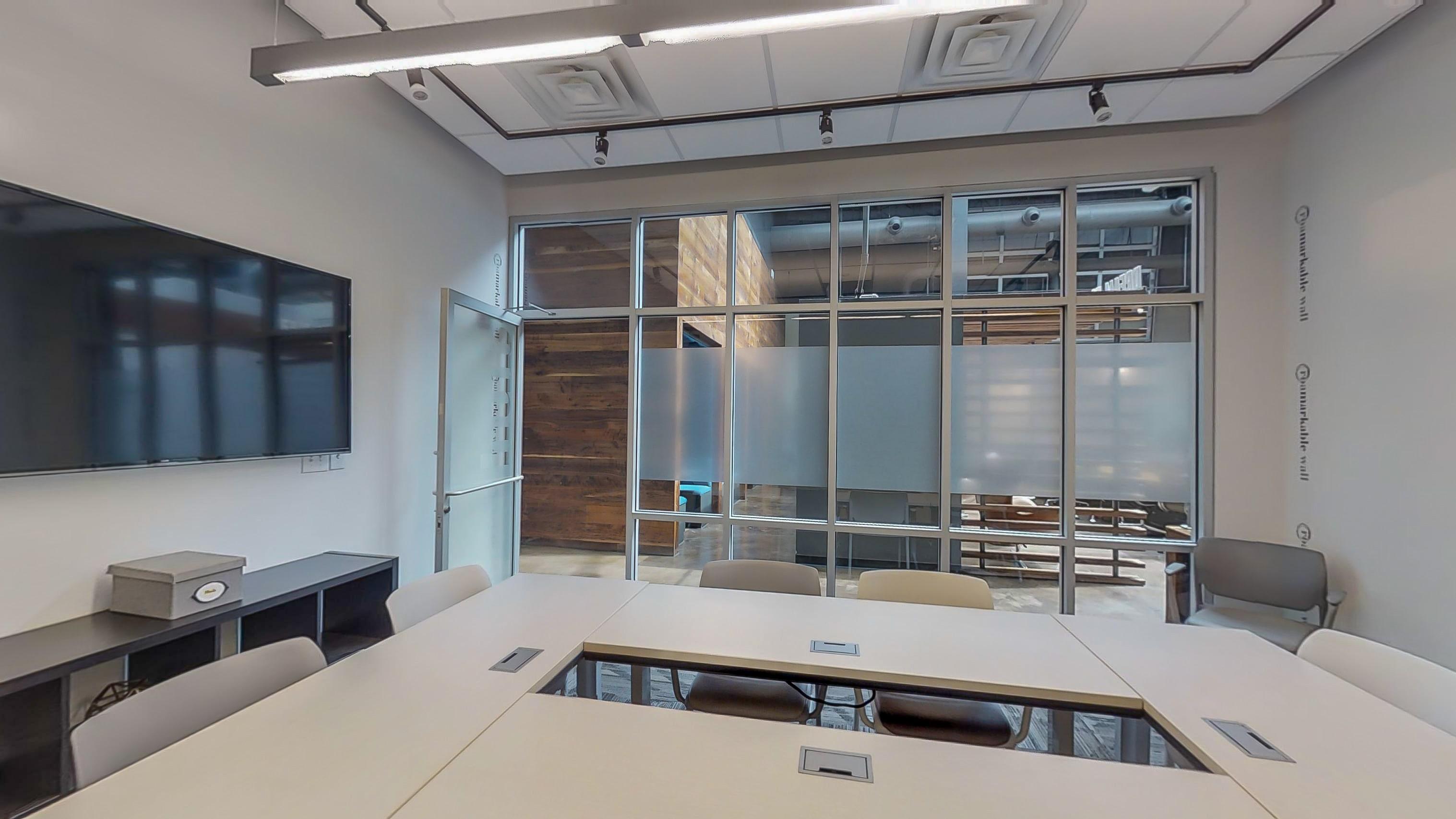 Meeting room with windows at Roam in Atlanta, GA
