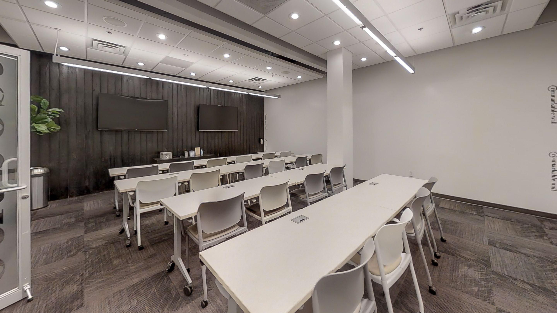 Training room with classroom seating at Roam Galleria in Atlanta, GA