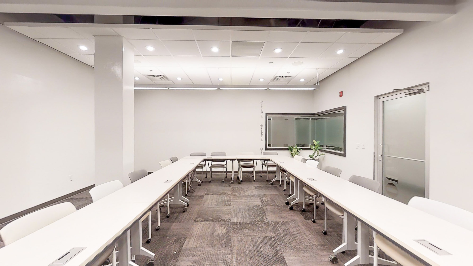 Ushape seating and frosted window in Roam Galleria meeting room