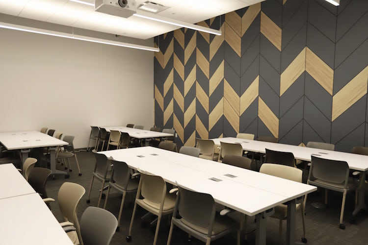 Theatre meeting room at Roam Perimeter Center with pod-style seating arrangement