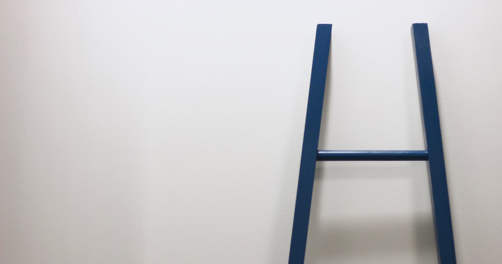 White wall and blue ladder at Roam Innovative Workplace