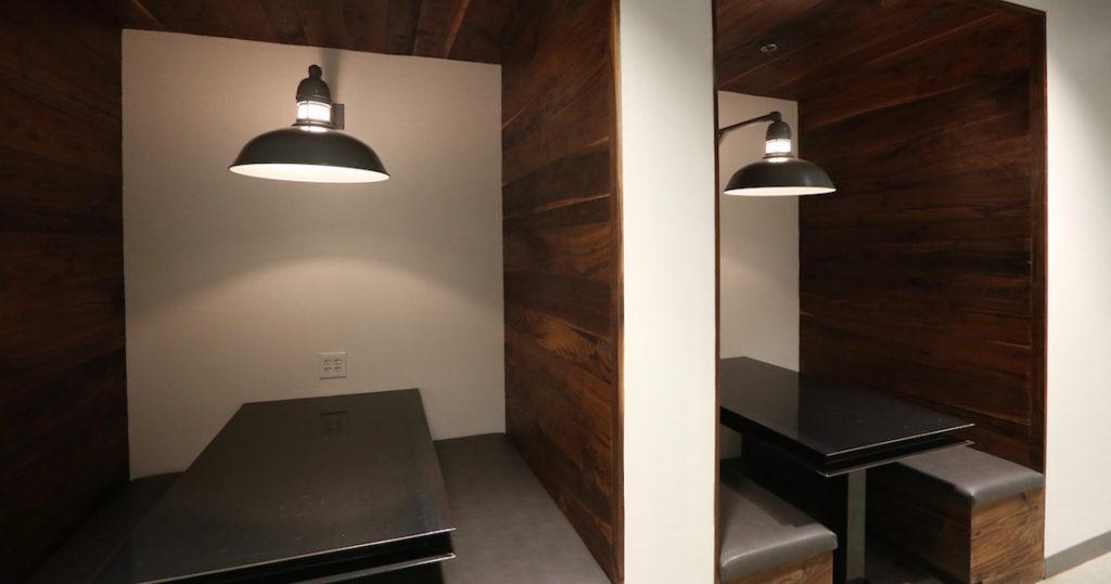 2 wood coworking booths at Roam Buckhead