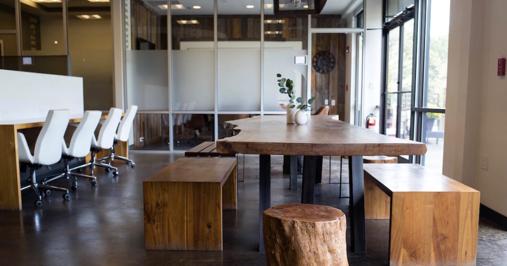 Community table and coworking space at Roam Alpharetta