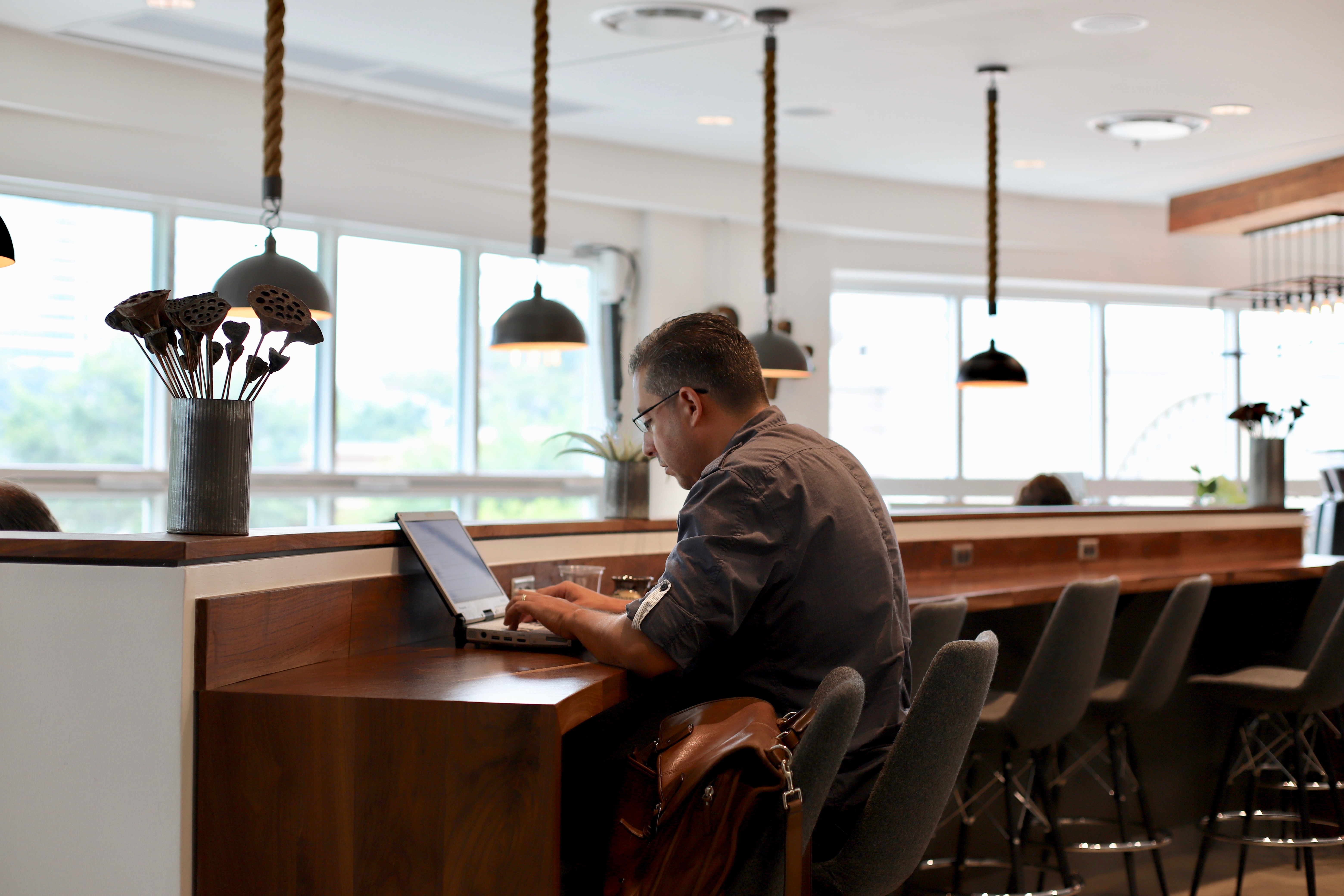 Member working at Coffee Bar at Roam Buckhead
