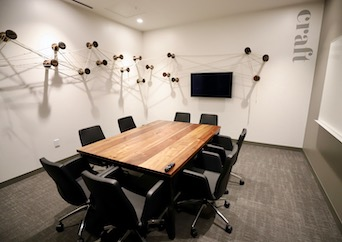 Meeting room seating 8 people at Roam Perimeter Center