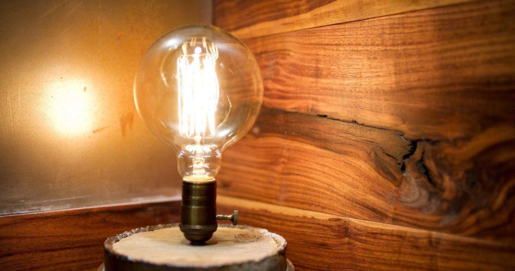 Edison light bulb and wood