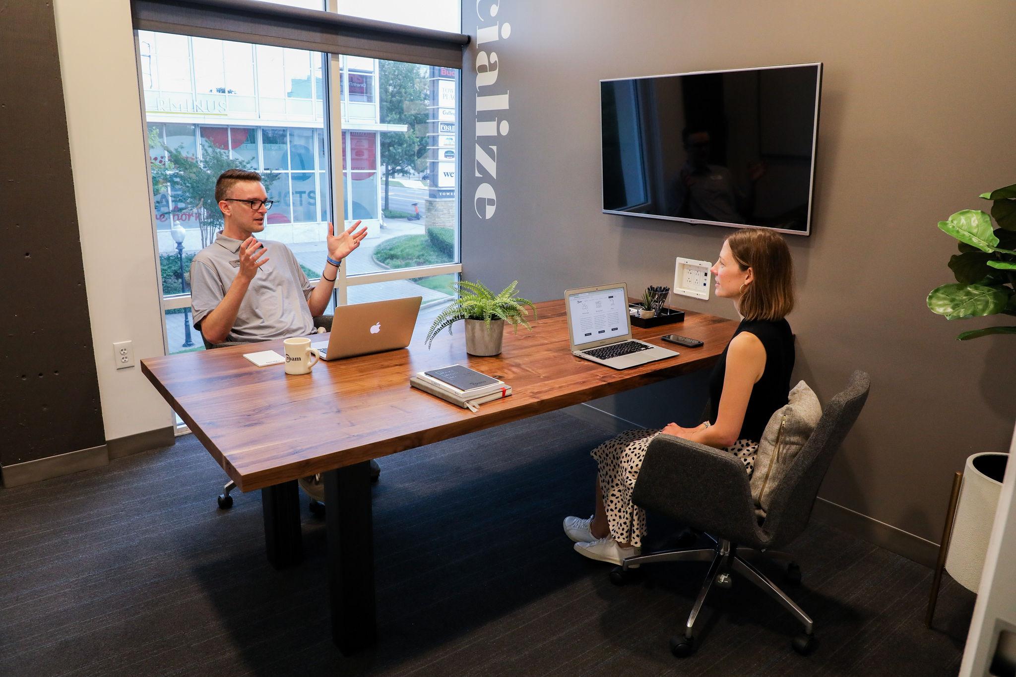 Team meeting in Buckhead office with windows