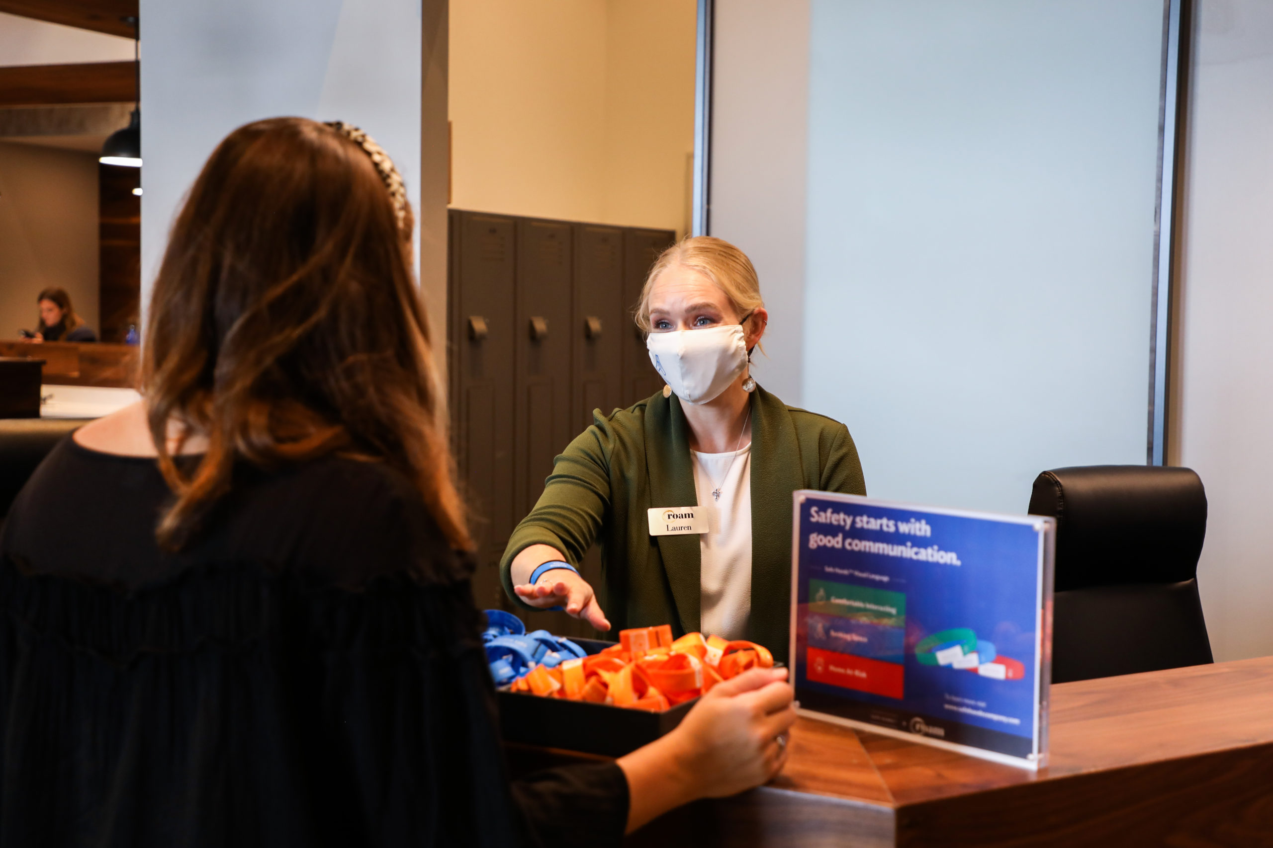 Employee with masking helping guest